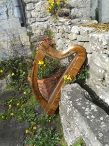 A small wire harp in the style of the Brian Boru or Trinity Harp.