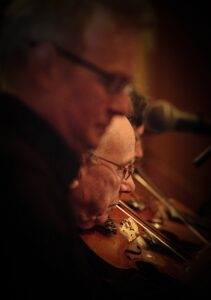 Brendan Wade on pipes, Paddy Ryan and Paul Dooley on fiddle on a freezing night in Zurich, 2012. Minus 15 outside.